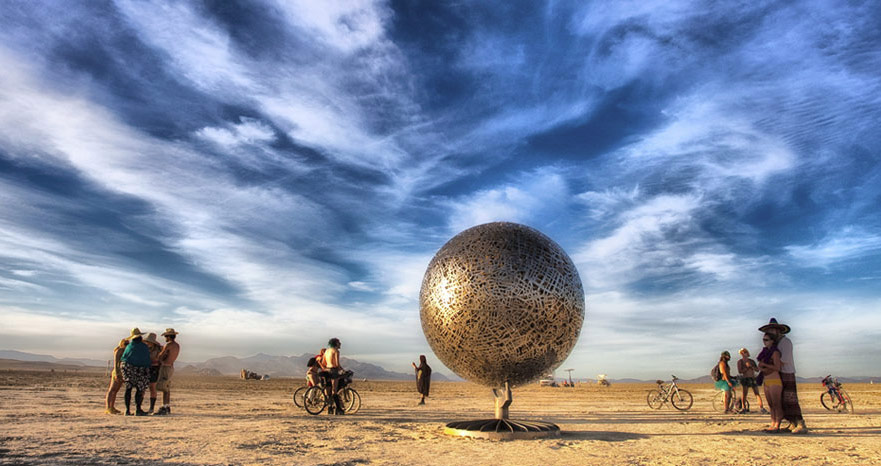 HOME is a 14ft tall illuminated globe rotating on the same axis as the planet.  It is was created using multiple layers of metal cut in the shapes of street maps from cities around the world.  13 ft tall x 10 feet wide